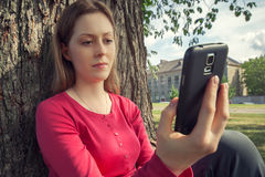 Young woman with smartphone Stock Photo