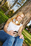 Young woman with smartphone in summer Royalty Free Stock Images
