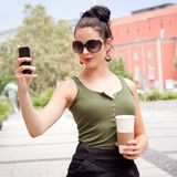 Young woman with smartphone and sunglasses Royalty Free Stock Photo