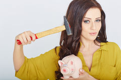 Young woman smashed piggy bank with a hammer Stock Photos