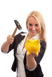 Young woman smashing piggy bank Stock Image