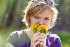 Young woman smell dandelion Stock Image