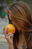 Young woman smell a fruit Royalty Free Stock Photo