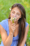 Young woman smelling bouquet Stock Photography