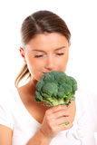Young woman smelling broccoli Royalty Free Stock Photography