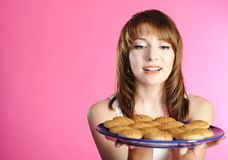 Young woman smelling cookies Royalty Free Stock Photography
