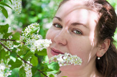 Young Woman Smelling Flower Stock Images