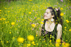 Young woman smelling the flowers Stock Photos