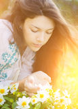 Young woman smelling flowers. Stock Photos