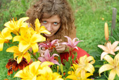 Young woman smelling lilies Stock Photography