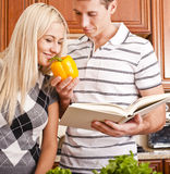 Young Woman Smelling Pepper Held by Young Man Royalty Free Stock Image