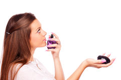 Young woman smelling perfume bottle Royalty Free Stock Photos