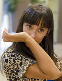 Young woman smelling perfume on her arm Stock Photo