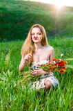 Young Woman smelling poppy, bouquet Stock Images