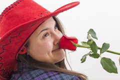 A young woman smelling a rose on white Royalty Free Stock Photography