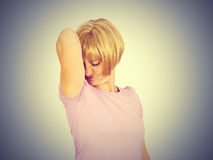 Young woman, smelling, sniffing her wet armpit Stock Images
