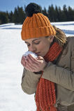 Young woman smelling snow Stock Image