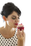 Enjoying a cupcake Stock Photography
