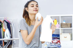 Young woman smells of detergent. Young woman smells of  detergent Stock Photography