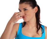 Young woman smells something awful. Attractive young woman smeels something awful. All on white background stock images