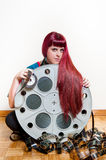 Young woman smile behind big movie cinema reel with filmstrip ro Stock Photo