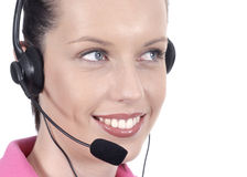 Young female adult woman with smile and telephone headset, looking sideways, white background Stock Photo