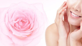Young woman smile mouth with pink rose flower Royalty Free Stock Images