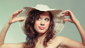 Young woman smile and touch hat. Stock Photo