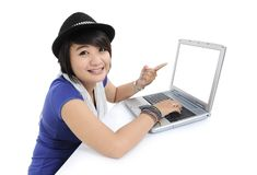 Young woman smiled and pointed to the laptop. On white background Royalty Free Stock Images