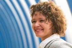 Young woman smiles Stock Photos