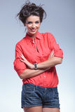 Young woman smiles with arms crossed Royalty Free Stock Photo