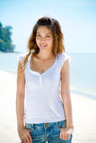 Young woman smiles by the beach Royalty Free Stock Images