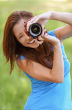 Young woman smiles and photographs Royalty Free Stock Photo