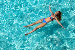 Young woman smiles, swiming in ocean, Royalty Free Stock Image