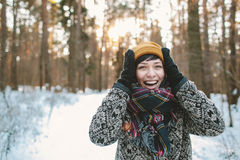 Young woman smiles in winter forest Stock Photography