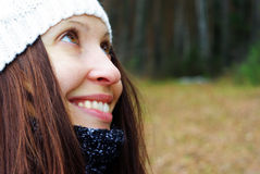 Young woman smiling. Portrait of beautiful woman in autumn outdoors Royalty Free Stock Photos