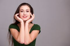Young woman smiling with against on face. Portrait of young woman smiling with against on face Royalty Free Stock Photography