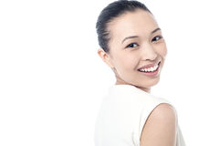 Young woman smiling against white Stock Photo