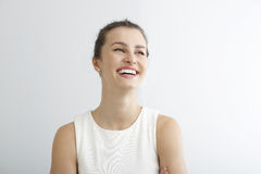 Young woman smiling against white background Royalty Free Stock Images
