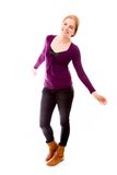Young woman smiling with arm outstretched Stock Photo