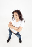 Young woman smiling with arms crossed Royalty Free Stock Images