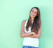 Young woman smiling with arms crossed Stock Images