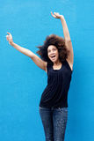 Young woman smiling with arms raised Royalty Free Stock Photos