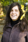 Young woman smiling with autumn leaf Stock Images