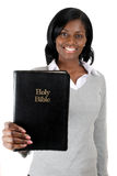 Young woman smiling with a bible. This is an image of woman smiling with a bible Royalty Free Stock Image