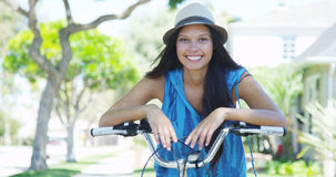 Young woman smiling on bike Stock Photo