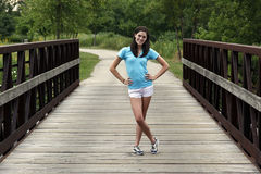 Young woman smiling on a bridge Stock Images