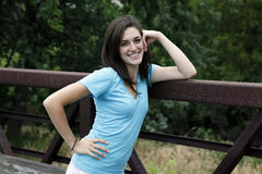Young woman smiling on a bridge Royalty Free Stock Photo