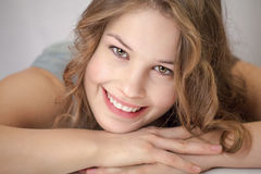 Young woman is smiling at camera 2 Stock Images