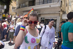 Young woman smiling at the camera at Pride Parade Royalty Free Stock Photography